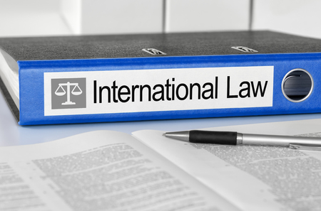 international law: Blue folder with the label International Law Stock Photo