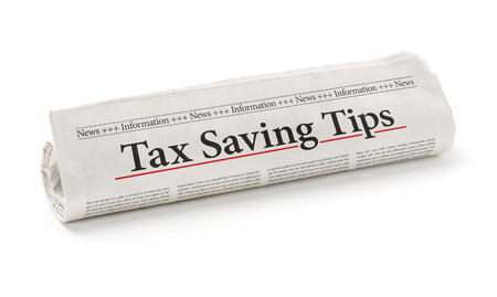 tax tips: Rolled newspaper with the headline Tax saving tips