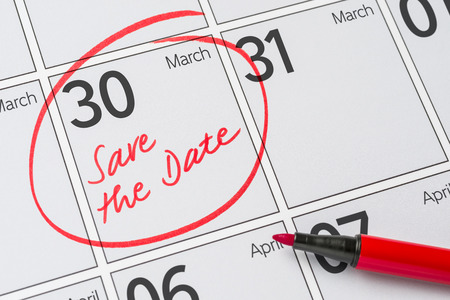 Save the Date written on a calendar - March 30