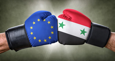 la union hace la fuerza: A boxing match between the European Union and Syria Foto de archivo