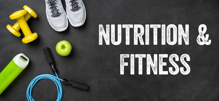 Fitness equipment on a dark background - Nutrition and Fitness