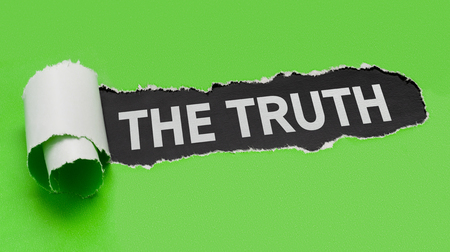 Torn green paper revealing the words The Truth Stock Photo