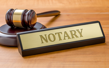 A gavel and a name plate with the engraving Notary Stock Photo