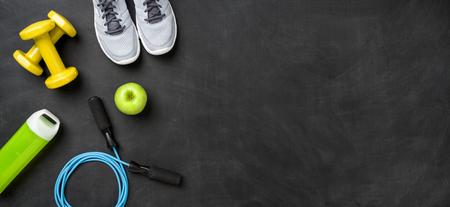 Fitness equipment on a dark background with copy space Stockfoto