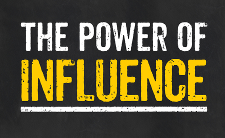 Blackboard with the text The power of influence