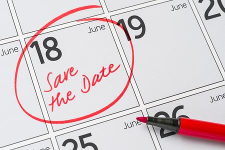 Save the Date written on a calendar - June 18 Stock Photo
