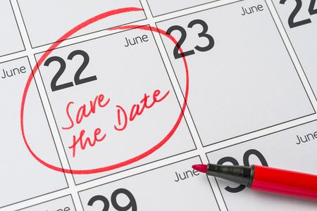 Save the Date written on a calendar - June 22 Stock Photo