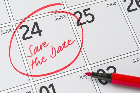 Save the Date written on a calendar - June 24 Stock Photo