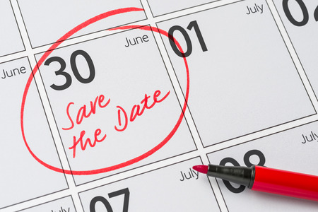 Save the Date written on a calendar - June 30 Foto de archivo