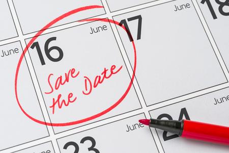Save the Date written on a calendar - June 16
