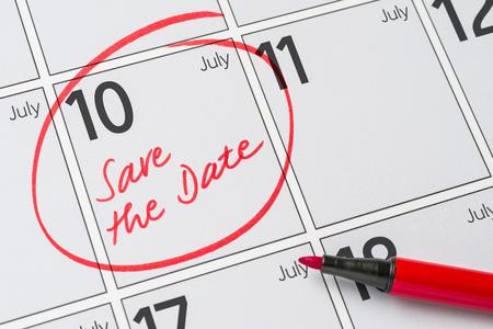 Save the Date written on a calendar - July 10 Фото со стока
