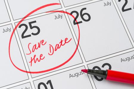 Save the Date written on a calendar - July 25 Фото со стока