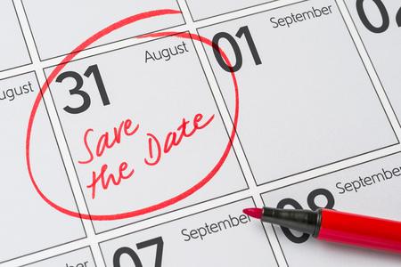 Save the Date written on a calendar - August 31