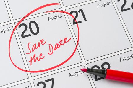 Save the Date written on a calendar - August 20 Фото со стока