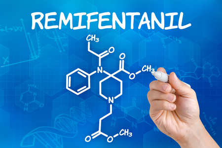 anaesthesia: Hand with pen drawing the chemical formula of Remifentanil