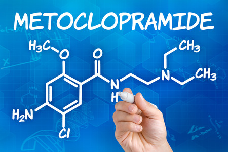pen and marker: Hand with pen drawing the chemical formula of Metoclopramide