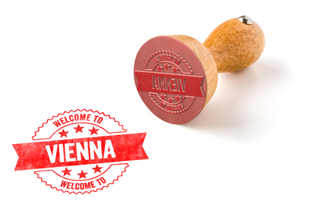 A rubber stamp on a white background - Welcome to Vienna