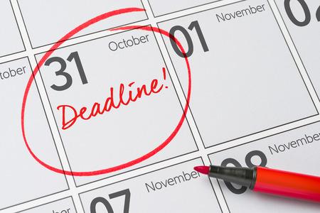 Deadline written on a calendar - October 31 Stock Photo