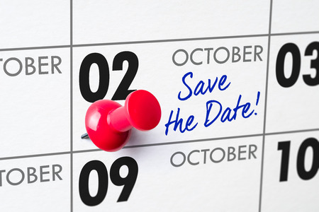 Wall calendar with a red pin - October 02