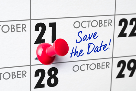 Wall calendar with a red pin - October 21