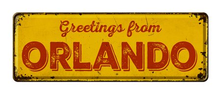 Vintage metal sign on a white background - Greetings from Orlando Stock Photo