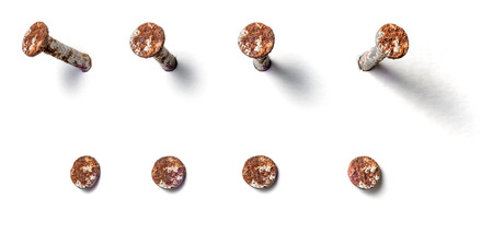 Rusty nail from different perspectives on a white background Stock Photo