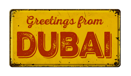 tin: Vintage metal sign on a white background - Greetings from Dubai