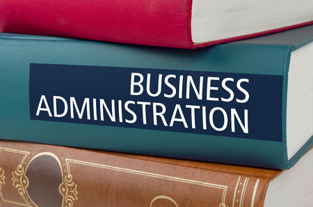 A book with the title Business Administration written on the spine Stock Photo
