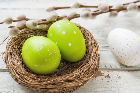 An easter nest with green easter eggs 写真素材