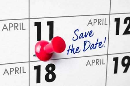 Wall calendar with a red pin - April 11 Фото со стока