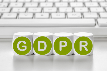 Letter dice in front of a keyboard - GDPR