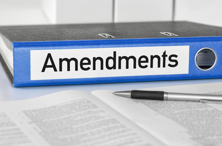 A blue folder with the label Amendments Stok Fotoğraf - 99090624