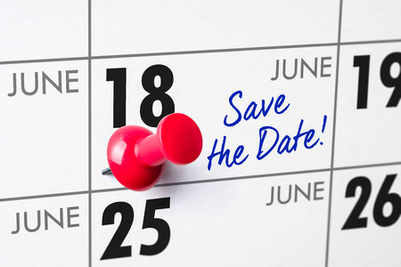 Wall calendar with a red pin - June 18
