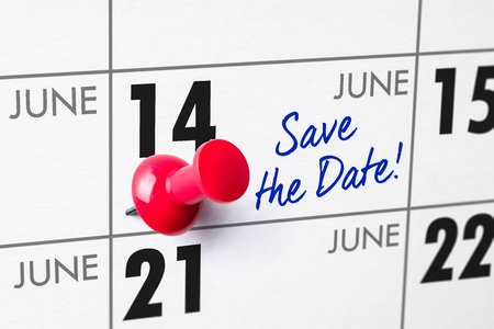 Wall calendar with a red pin - June 14