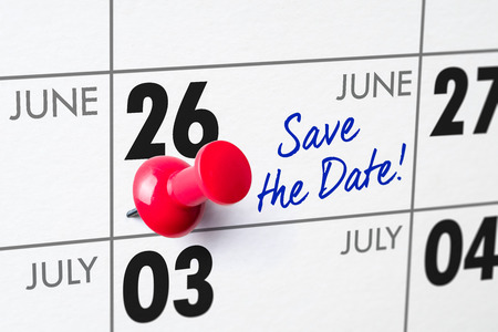 Wall calendar with a red pin - June 26