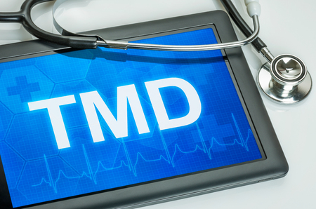 Tablet with the text TMD on the display
