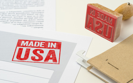 A red stamp on a document - Made in USA