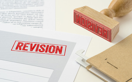 A red stamp on a document - Revision Archivio Fotografico