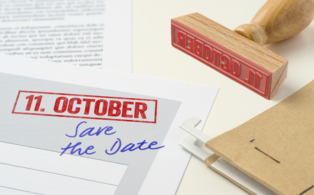 A red stamp on a document - October 11