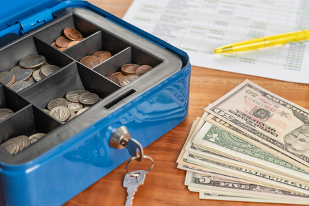 A cash box with banknotes and coins