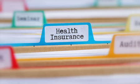 File folders with a tab labeled Health Insurance Banque d'images - 111163775