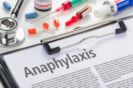 The text Anaphylaxis written on a clipboard