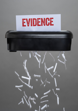 A shredder destroying a document - Evidence