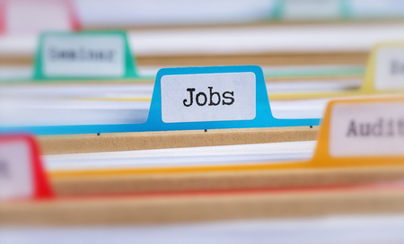 File folders with a tab labeled Jobs Stock Photo