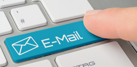 A keyboard with a blue labeled button - E-Mail Stock Photo