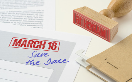 A red stamp on a document - March 16 Stock Photo