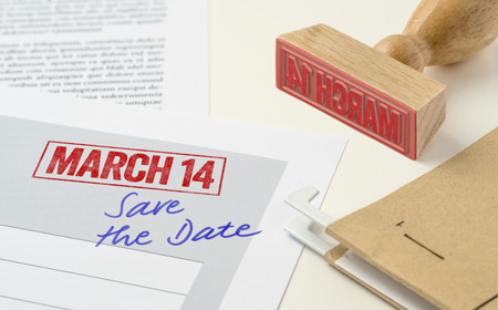 A red stamp on a document - March 14