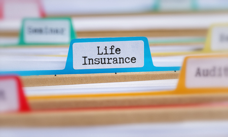 File folders with a tab labeled Life Insurance Stock Photo