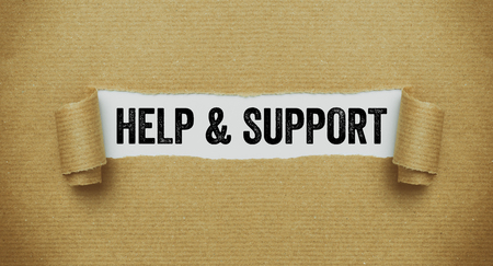 Torn brown paper revealing the word Help and Support
