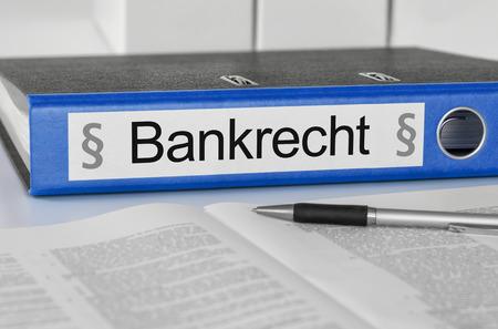 Blue folder with the german label Bankrecht - Banking Law Imagens